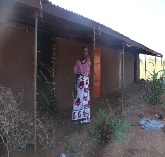 Regina is now a proud owner of a semi permanent house in Rupa trading center. She built it from her earnings in mining
