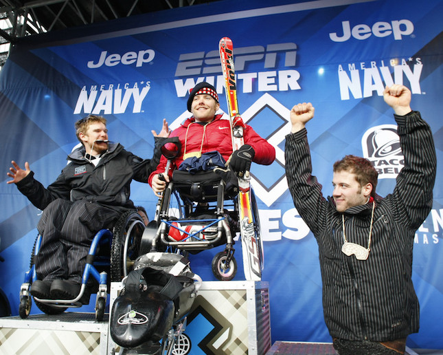 January 31, 2010-Aspen,CO-Buttermilk Mountain: silver medalist Gregory Peck,left and breonze medalist Kevin Connley,right,join gold winner Tyler Walker on the awards stage for Mono Skier X at X Games 14.