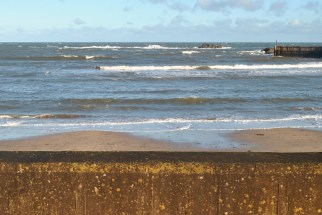 sea wall eyemouth winter blue sky