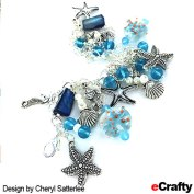Make this beautiful sea glass, pearls and seashore charm bracelet with just a few supplies from eCrafty.com