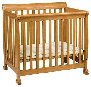 DaVinci Kalani 2-in-1 Mini Crib and Twin Bed In Honey Oak Finish