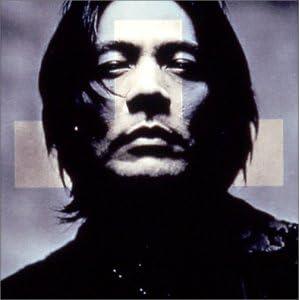 Sur la pochette, le visage de Himuro Kyosuke, en noir et blanc, barré d'une croix.