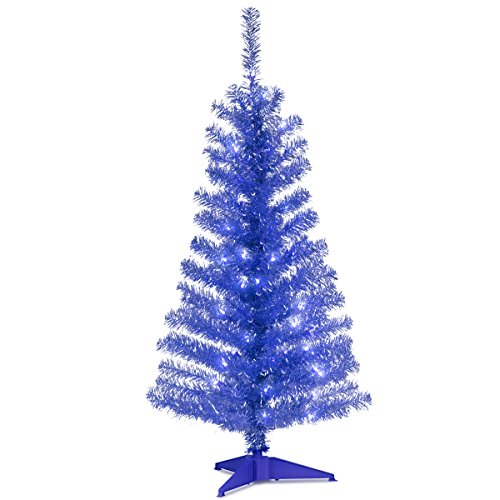 blue tinsel wrapped tree with clear lights
