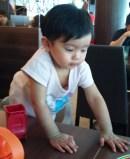 Child not sitting still in restaurant