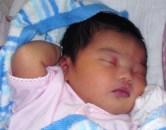 Baby Sleeping scratching head