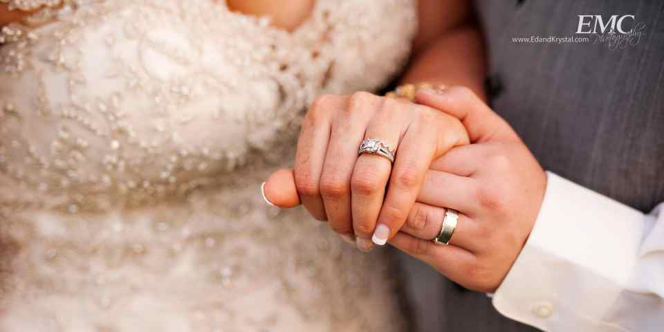 Cole and Liz hold hands in a close-up shot of their rings.