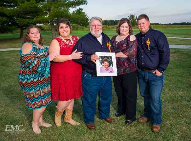 Family photo including portrait of mom.