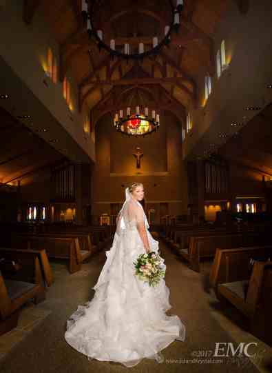 Ashley poses with her bouquet at St. Patrick's of Merna in Bloomington before her wedding.