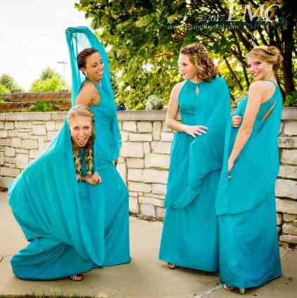 Give them a few minutes to play and bridesmaids prove their dresses can be a lot of fun.