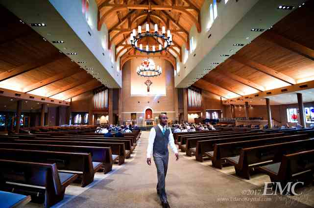 Groomsman paces as he waits for the beginning of the ceremony at St. Patrick's of Merna