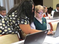 Coleman working with Woodlawn student Lora Azbell on her resume at the Career Development Conference in March.
