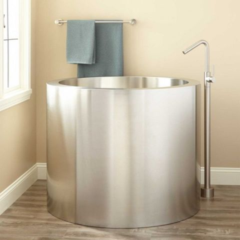 A small circular silver tub would fit seamlessly into a less than spacious bathroom. $2,986; signaturehardware.com