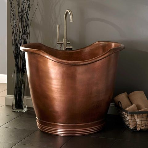 An antique copper exterior and miniature size make this tub a true standout. $3,541; signaturehardware.com