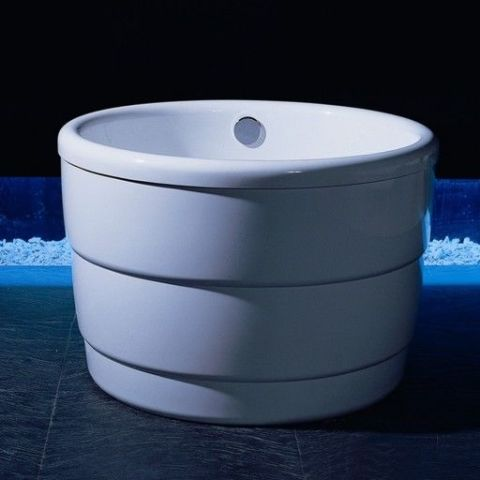 This high gloss tub has a futuristic feel, thanks in part to its perfectly circular shape and unobtrusive fixtures. $2,606; bathtubsplus.com