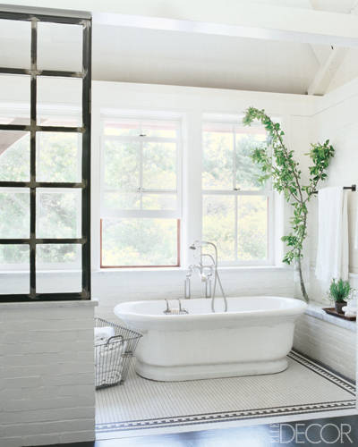 An antique earthenware tub from LooLoo Design in the master bath; the towel bars are by Rocky Mountain Hardware, and the mosaic floor is by Daltile. For a full tour of Meg Ryan's beautiful beach house, decorated with the help of Marsha Russell of Satinwood, click here.