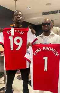 Mr Eazi and King Promise with their customized jerseys