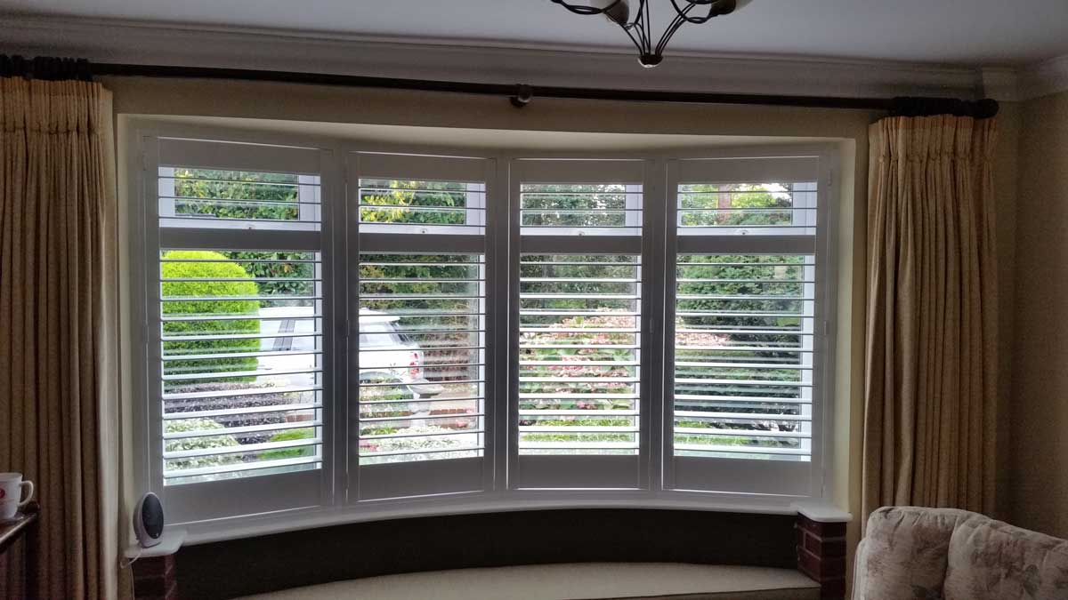 Plantation Shutters In A Living Room Bay Window For House In