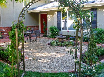 English Tea Garden Patio with gravel, fountain and roses