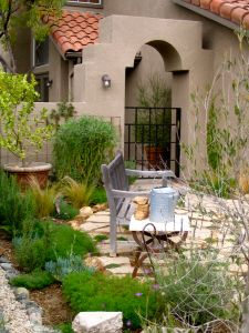 Front yard garden with garden bench and mediterranean plants by shirley bovshow