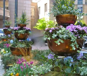 three tiered garden containers in copper