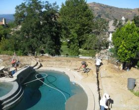 trenching for pipes during pool makeover