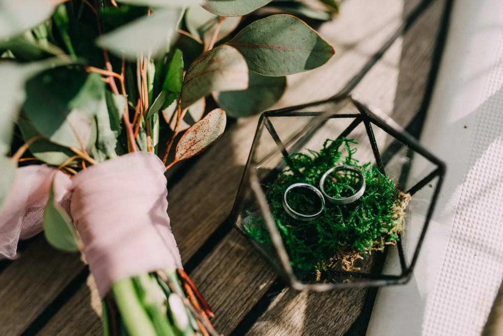 rings beside a bouquet