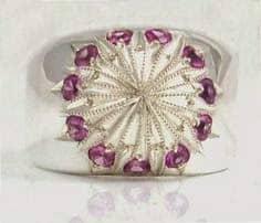 Guardar joyas por separado como este anillo de plata con engarce fino de once piedras
