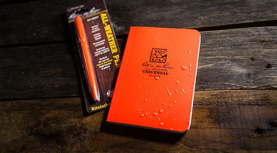 Rite in the Rain Blaze Orange notebook and pen