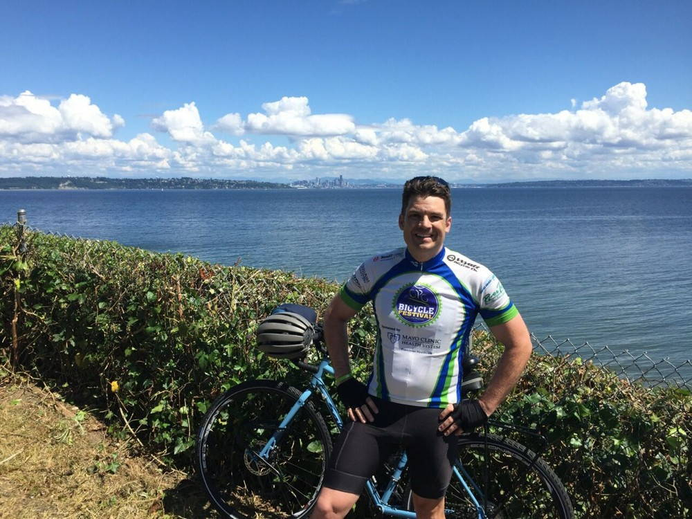 """Longhurst has been giving the """"public"""" humanities a whole new meaning during the Bike Battles bike/book tour. Here's the author during a recent stop on Bainbridge Island, Washington."""