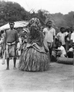 Bassa Devil and attendants on Division 2 of the Firestone Plantations Company, once the traditional lands of the Bassa people. Loring Whitman, August 11, 1926. Indiana University Liberian Collections.