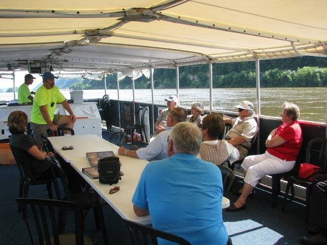 """After a childhood and commercial fishing career on the Mississippi, Captain Robert Vavra now leads boat tours of the river and wildlife refuge near MacGregor, Iowa. Source: <a href=""""http://www.visitiowa.org/business/maiden-voyage-tours.html"""" target=""""_blank"""">Northeast Iowa Tourism Association</a>"""