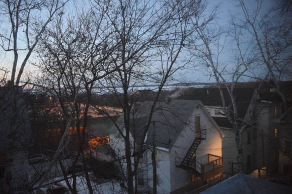 Fig. 2. View from enclosed area on third floor of Robert Lamp House (1903), formerly a roof garden, looking northeast toward Lake Mendota. The view sill affords some glimpses of the lake, which Wright intended to bring nature into the home. Photo by Chris Slaby, February, 2016.