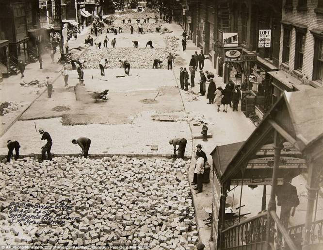Workers in 1930 laying bricks for 28th Street in Manhattan. Image from New York Municipal Archives & Daily Mail.