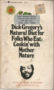 """<a href=""""https://www.amazon.com/Dick-Gregorys-natural-diet-folks/dp/0060116048"""" target=""""_blank"""">A cookbook</a> that promises an introduction to natural foods even for those not ready to replace steaks with soy."""