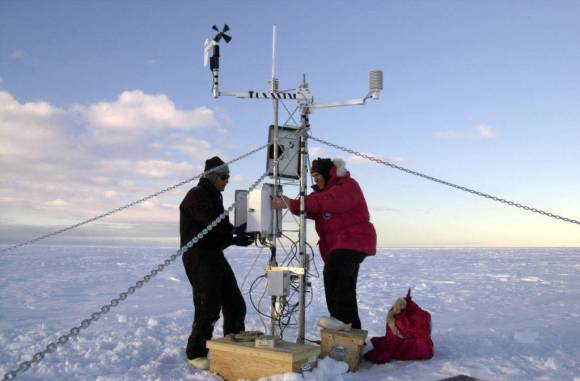 Scientists set up equipment on an iceberg to measure climate change. Public domain.