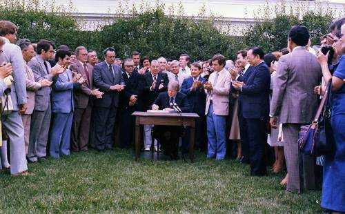 President Jimmy Carter signs the Surface Mining Control and Reclamation Act, August 3, 1977. Photo by White House staff photographer.