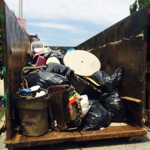 A nearly full dumpster at an intervention in which the research team and community partners cleared garbage from just two blocks in Baltimore. Photo by Dawn Biehler, 2016.