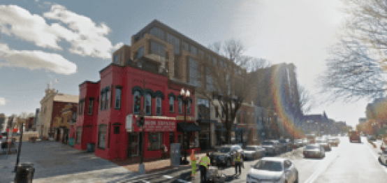 The corner of 7th St. and T St. The Howard Theater (far left) stands next to luxury apartments squeezed behind old storefronts. Image from Google Street View.