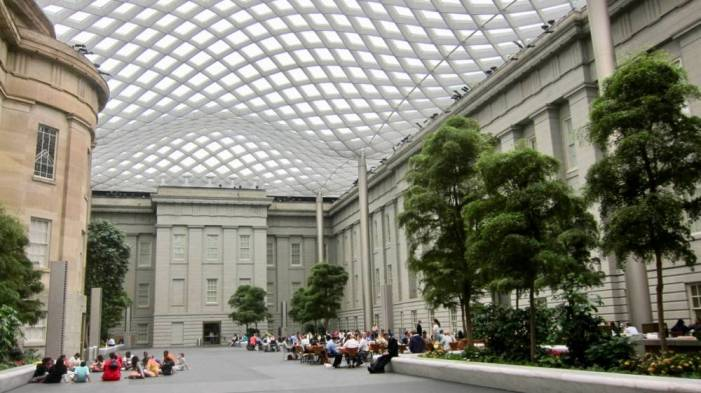 """In the nineteenth century, the Patent Office Building housed a """"cabinet of curiosities"""" for tourists. Today, visitors enjoy the Kogod Courtyard. Image courtesy of <a href=""""https://commons.wikimedia.org/wiki/File:Kogod_Courtyard_-_Old_Patent_Office_Building.JPG"""" target=""""_blank"""" rel=""""noopener"""">Wikimedia Commons</a>."""