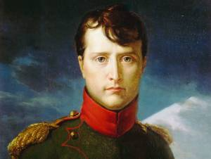 A portrait of a young Napoleon Bonaparte in military dress starting at the viewer with a white mountain and blue clouds behind him.