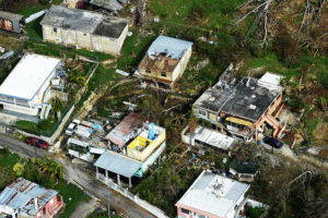 An aerial view of homes missing roofs in Puerto Rico.