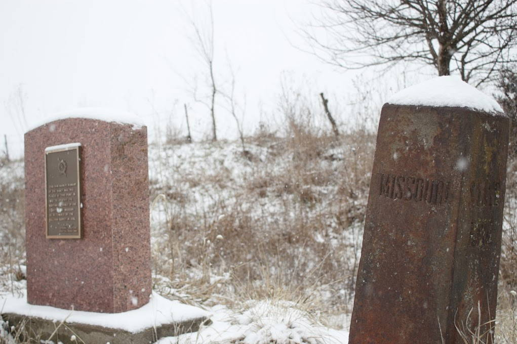 A snow covered monument to the Honey War.