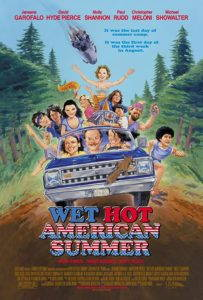 A movie poster showing a group of people in a car driving down a dirt road.