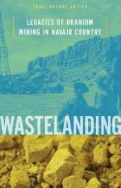 Book cover of Wastelanding by Traci Brynne Voyles, yellow pieces of uranium and a uranium mine with people looking on