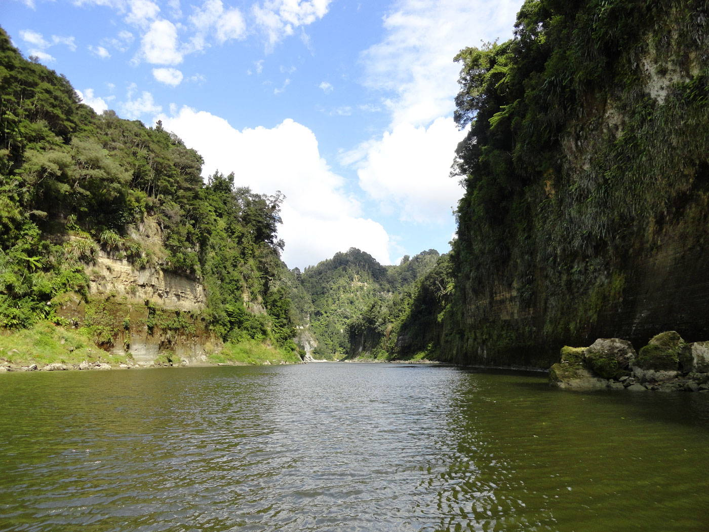 A river with steep banks and a sunny sky