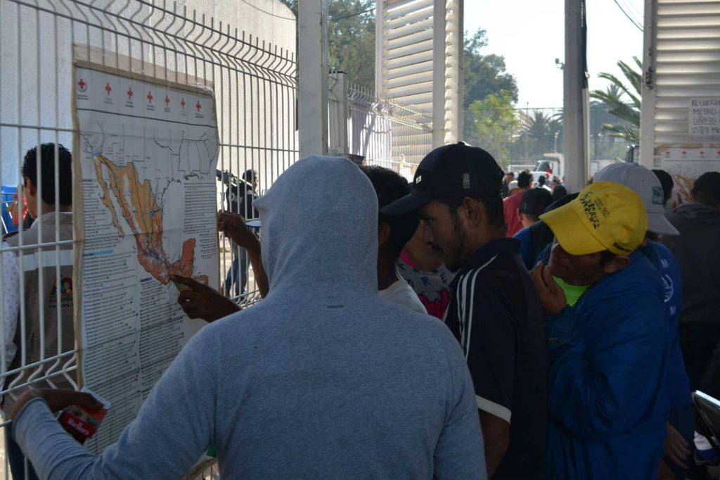 Migrants points to map of Central America