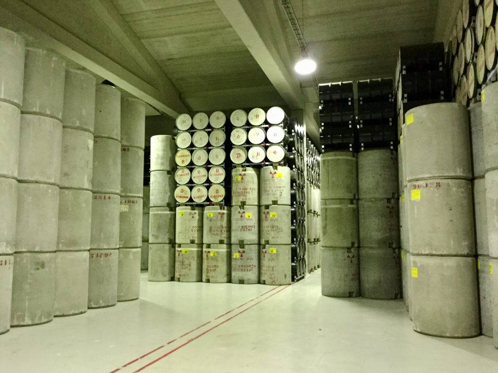 Stacked concrete barrels in a warehouse