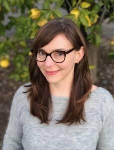 Portrait of a brunette woman wearing glasses