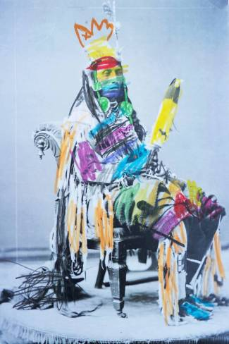 A Xeroxed black-and-white photograph of an indigenous chief filled in with dashes of color.