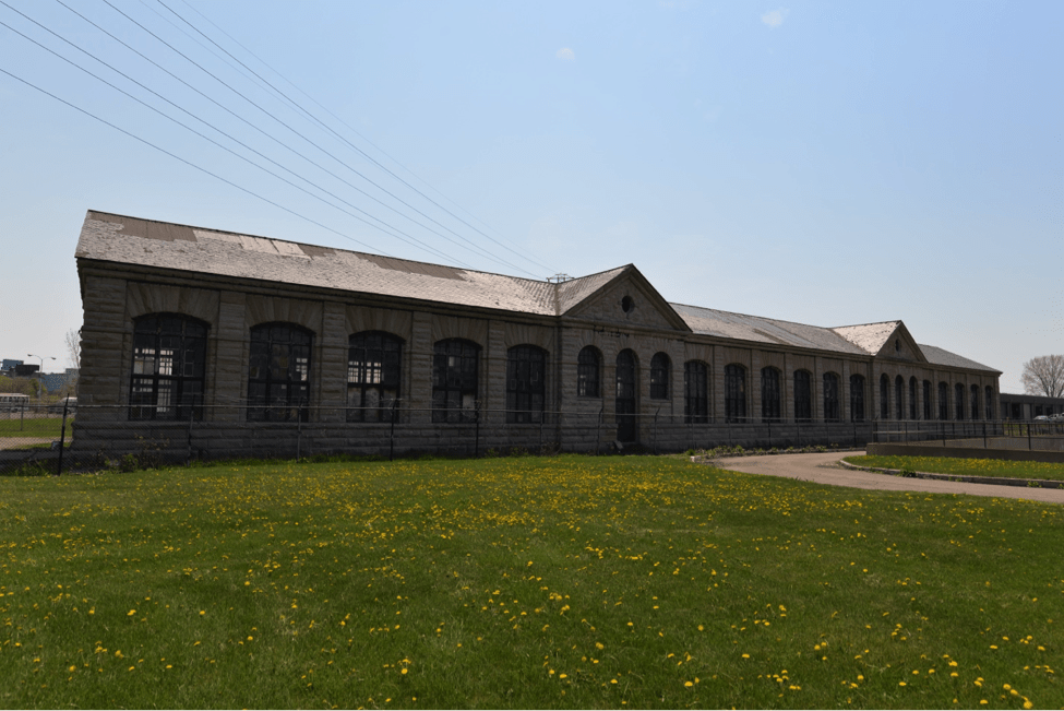 Abandoned power station in an open grassy field